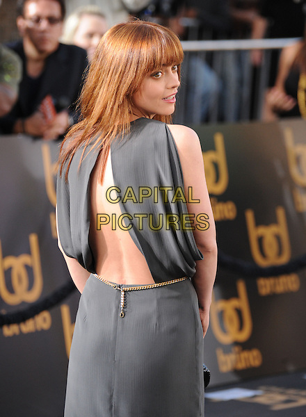 "CHRISTINA RICCI.The Universal Pictures' L.A. Premiere of ""Bruno"" held at the Grauman's Chinese Theatre in Hollywood, California, USA. .June 25th, 2009.half length grey gray sleeveless backless dress looking over shoulder .CAP/DVS.©Debbie VanStory/Capital Pictures."