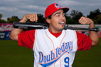 Auburn Doubledays third baseman Anthony Rendon #9 jokingly poses for a photo when teammates prompted him to flex for the image before game two of the semi-final round of the NY-Penn League Playoff series against the Vermont Lake Monstes at Falcon Park on September 8, 2011 in Auburn, New York.  Auburn defeated Vermont 3-2.  (Mike Janes/Four Seam Images)