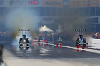 Apr. 28, 2013; Baytown, TX, USA: NHRA top fuel dragster driver Tony Schumacher (left) smokes the tires racing alongside Shawn Langdon during the Spring Nationals at Royal Purple Raceway. Mandatory Credit: Mark J. Rebilas-