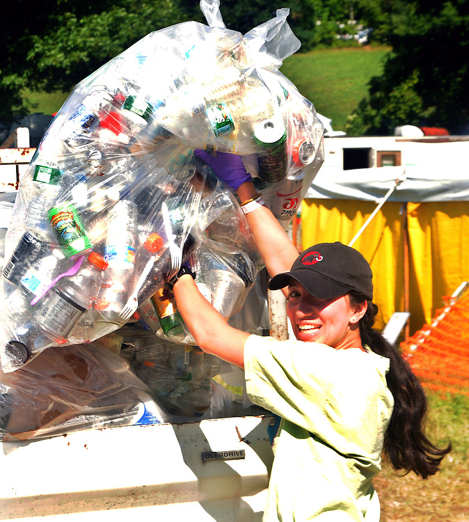 Volunteers collecting trash at the Falcon Ridge Folk Festival, held on Dodd's Farm in Hillsdale, NY on Saturday, August 1, 2015. Photo by Jim Peppler. Copyright Jim Peppler 2015.