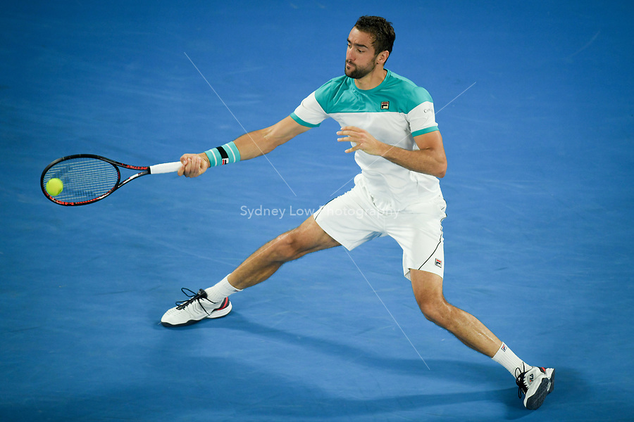 January 28, 2018: Number six seed Marin Cilic of Croatia in action in the Men's Final against number two seed Roger Federer of Switzerland on day fourteen of the 2018 Australian Open Grand Slam tennis tournament in Melbourne, Australia. Photo Sydney Low