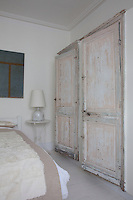Two built-in cupboards, decorated with distressed paint-work house laundry in the guset bedroom
