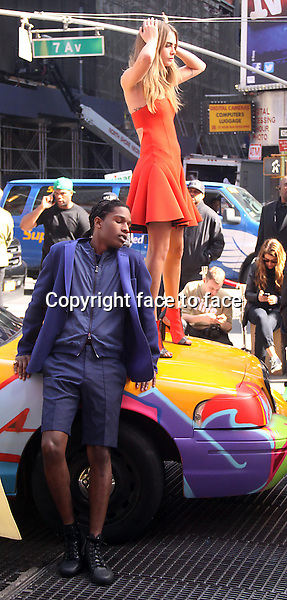 NEW YORK, NY - OCTOBER 14: Cara Delevingne and A$ap Rocky during a photo shoot for DKNY at Times Square in New York City. October 14, 2013.<br /> Credit: MediaPunch/face to face<br /> - Germany, Austria, Switzerland, Eastern Europe, Australia, UK, USA, Taiwan, Singapore, China, Malaysia, Thailand, Sweden, Estonia, Latvia and Lithuania rights only -