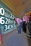 "9 June 2012: Washington Nationals owner Mark Lerner signs the wall inside the ""Green Monster"" prior to a game against the Boston Red Sox at Fenway Park in Boston, MA. The Nationals defeated the Red Sox 4-2 in the second game of their 3-game series. Mandatory Credit: Ed Wolfstein Photo"