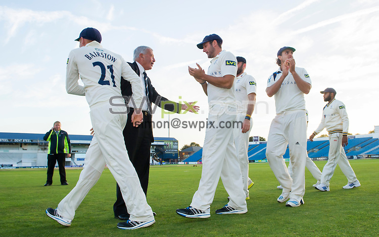 Picture by Allan McKenzie/SWpix.com - 26/09/2014 - Cricket - LV County Championship Div One - Yorkshire County Cricket Club v Somerset County Cricket Club - Headingley Cricket Ground, Leeds, England - Yorkshire Chairman Harold 'Dickie' Bird congratulates the players as they come out to receive the trophy.