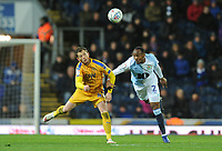 Blackburn Rovers' Ryan Nyambe vies for possession with Wigan Athletic's Joe Garner<br /> <br /> Photographer Kevin Barnes/CameraSport<br /> <br /> The EFL Sky Bet Championship - Blackburn Rovers v Wigan Athletic - Tuesday 12th March 2019 - Ewood Park - Blackburn<br /> <br /> World Copyright © 2019 CameraSport. All rights reserved. 43 Linden Ave. Countesthorpe. Leicester. England. LE8 5PG - Tel: +44 (0) 116 277 4147 - admin@camerasport.com - www.camerasport.com