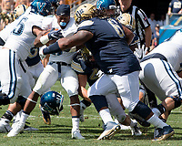 Pitt defensive lineman Tyrique Jarrett makes a tackle. The Pitt Panthers defeated the Villanova Wildcats 28-7 at Heinz Field, Pittsburgh, Pennsylvania on September 3, 2016.