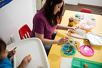 Lora Reyes is a licensed family childcare educator in Westfield, Mass., where she operates the daycare Lora's Little Ones out of her home on Thurs., June 2, 2016. Here she prepares lunch for a couple of the children. Today she was in charge of 7 children, aged 14 months to 5 years old, handling meals, playtime, and educational activities throughout the day, starting about 7am and going until 4:30pm. She uses the Mother Goose Time curriculum throughout the day. Reyes is currently pursuing an undergraduate degree in Psychology at Holyoke Community College. She started 2 years ago after earning a Child Development Associate certification.
