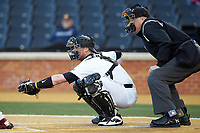 Wake Forest Demon Deacons catcher Shane Muntz (11) frames a pitch as home plate umpire Frank Sylvester looks on during the game against the Florida State Seminoles at David F. Couch Ballpark on March 9, 2018 in  Winston-Salem, North Carolina.  The Seminoles defeated the Demon Deacons 7-3.  (Brian Westerholt/Four Seam Images)