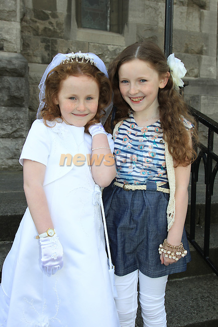 Niamh Donnelly and Jessica Donnelly.at Scoile Fatima First Communion in St Marys Church..Picture  www.newsfile.ie..