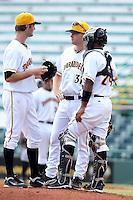 Bradenton Marauders Mike Steele #31 talks with pitcher Brett Sinkbeil (left) and catcher Carlos Paulino #24 during a game against the Jupiter Hammerheads at McKechnie Field on June 22, 2011 in Bradenton, Florida.  Bradenton defeated Jupiter 5-4.  (Mike Janes/Four Seam Images)