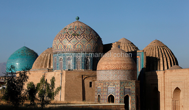 "General view of Mausoleums of the middle group, Shah-I Zinda Complex, from right to left: Unknown mausoleum, Mausoleum of the 1380s,  Octagonal pavilion, dome of the ""double dome mausoleum"", Samarkand, Uzbekistan, pictured on July 19, 2010, at dawn. The Shah-i-Zinda Complex is a necropolis of mausoleums whose legendary origin dates back to 676 when Kussam-ibn-Abbas arrived to convert the locals to Islam. So successful was he that he was assassinated whilst at prayer. His grave remains the centre of the sacred site which grew over many centuries, especially the 14th and 15th, into an architecturally stunning  example of ceramic art. Samarkand, a city on the Silk Road, founded as Afrosiab in the 7th century BC, is a meeting point for the world's cultures. Its most important development was in the Timurid period, 14th to 15th centuries. Picture by Manuel Cohen."