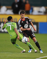 DC United midfielder Chris Pontius (13) goes against Seattle Sounders defender James Riley (7)    DC United defeated The Seattle Sounders 2-1 at  RFK Stadium, Wednesday May 4, 2011.