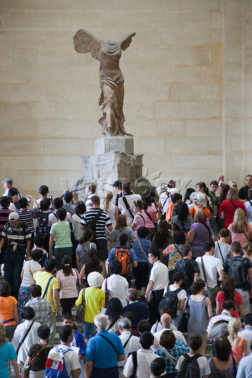 """France,Paris,Louvre,Tourist Crowds and the Winged Victory of Samothrace"""