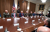 United States President Donald J. Trump participates in a briefing with senior military leaders in the Cabinet Room of the White House in Washington, DC on Monday, October 7, 2019.<br /> Credit: Ron Sachs / Pool via CNP
