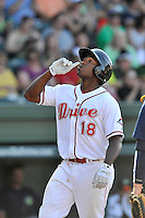 First baseman Josh Ockimey (18) of the Greenville Drive crosses home after hitting a home run in a game against the Columbia Fireflies on Sunday, May 8, 2016, at Fluor Field at the West End in Greenville, South Carolina. Greenville won, 5-4. (Tom Priddy/Four Seam Images)