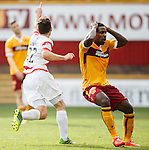 Tony Andreu celebrates the opening goal for Hamilton Accies as he beats the challenge of the despairing Zane Francis-Angol of Motherwell