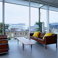 The lounge area is furnished with a leather sofa by Borge Morgensen, coffee table by Kurt Ostervig and a pair of Le Corbusier armchairs