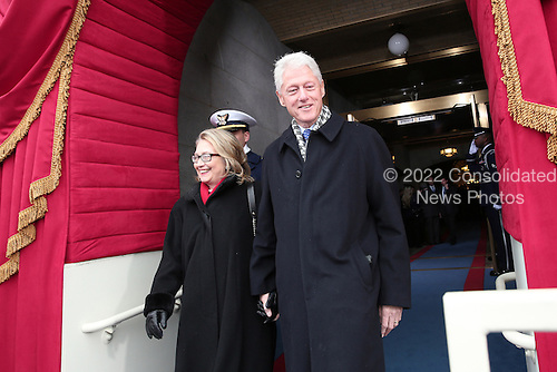 United States Secretary of State Hillary Clinton and former U.S. President Bill Clinton arrive during the presidential inauguration on the West Front of the U.S. Capitol January 21, 2013 in Washington, DC.   Barack Obama was re-elected for a second term as President of the United States.  .Credit: Win McNamee / Pool via CNP