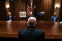 United States President Donald J. Trump, center, speaks during a meeting with members of the National Association of Police Organizations Leadership in the Cabinet Room of the White House in Washington, DC, on July 31st, 2020. At left is US Vice President Mike Pence and at right is John Kazanjian, President, Florida PBA.<br /> Credit: Anna Moneymaker / Pool via CNP /MediaPunch