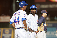South Bend Cubs pinch runner Andruw Monasterio (6) talks with coach Jimmy Gonzalez (44) during a game against the Burlington Bees on July 22, 2016 at Four Winds Field in South Bend, Indiana.  South Bend defeated Burlington 4-3.  (Mike Janes/Four Seam Images)