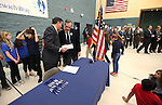 Gov. Brian Sandoval and state Superintendent Dale Erquiaga talk at Bordewich-Bray Elementary School in Carson City, Nev., on Wednesday, March 4, 2015, before a ceremony in which Sandoval signed a school bond bill into law.<br /> Photo by Cathleen Allison