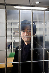 Tokyo, January 17 2013 - Portrait of Japanese researcher and designer Jun Rekimoto at his lab in Tokyo University behind a prototype comprising an assembly of liquid crystal modules.