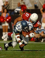 Nov. 6, 2005; Tempe, AZ, USA; Running back (37) Shaun Alexander of the Seattle Seahawks is tackled by linebacker (51) James Darling of the Arizona Cardinals at Sun Devil Stadium. Mandatory Credit: Mark J. Rebilas