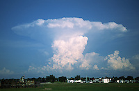 A summertime thunderstorm (cumulonimbus) produces a classic symmetrical anvil cloud during the mature phase of it's lifecycle southeast of Norman Oklahoma.