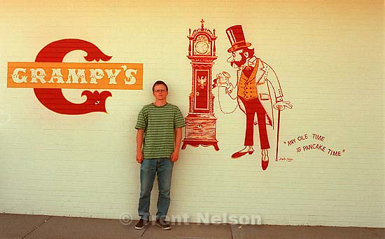 Anthony Quayle in front of &quot;Grampy's&quot; Pancake House logo with &quot;any ole time is pancake time&quot; slogan.<br />