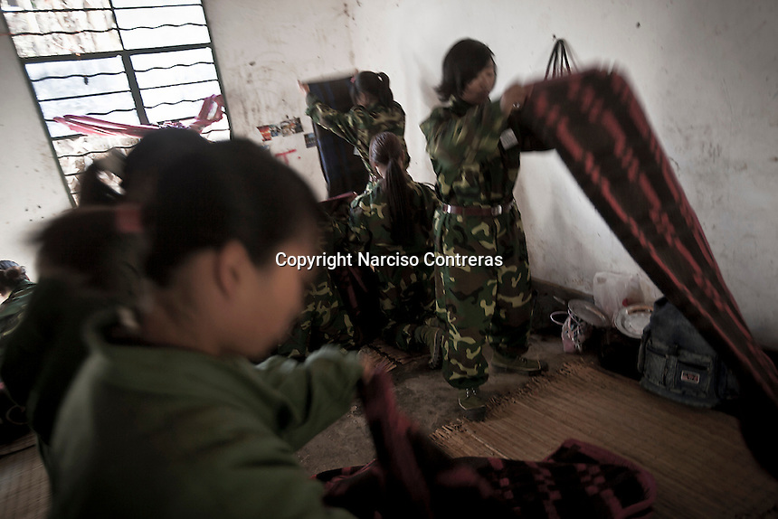 KIA female new recruits clean their barrack as part of their daily duty at the base camp outskirsts Maiya Jang city, the second largest city under control of the Kachin Independence rebel Army. Since the begining of the Kachin uprising for its sovereignty women always fought by side the rebel soldiers, but officially, the female KIA was founded in 2007, since then, up to 1500 women have joint to the rebel army. The KIA is enhancing its troops number since the ceasefire was broken out by the Burmese army last June 2011.