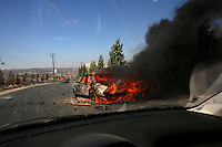 Bent Jbeil, Aug 5 2006.An Israeli tank fired a shell at an abandonned car in the outskirts of Bent Jbeil, a simple 'pot shot' without any military value whatsoever, raising questions about the discipline of the Israeli troops as well as the quality of their tactics...