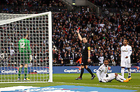 Pictured: Match referee Kevin Friend (C) is showing a red card to goalkeeper Matt Duke (L) for his foul against Jonathan de Guzman of Swansea on the ground (R). Sunday 24 February 2013<br /> Re: Capital One Cup football final, Swansea v Bradford at the Wembley Stadium in London.