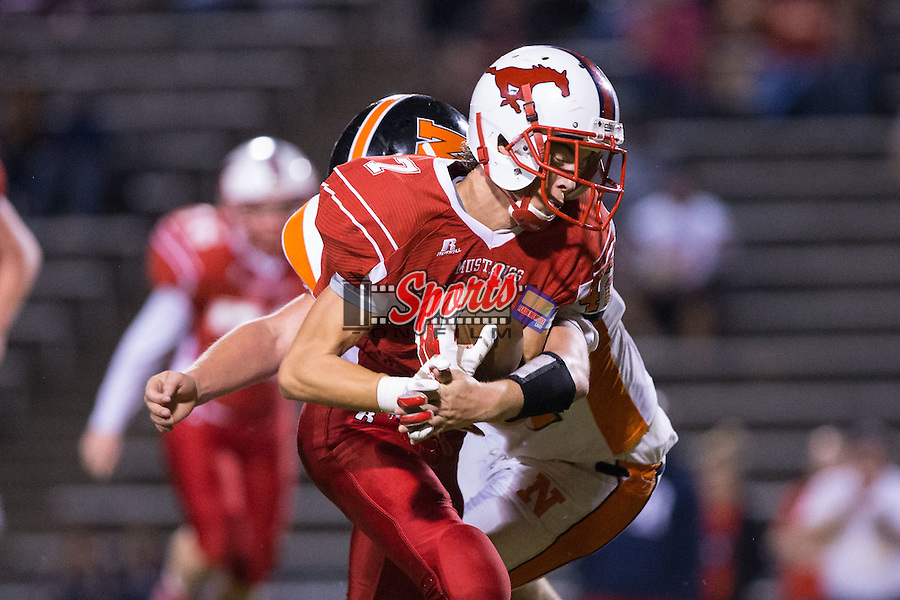 Colton Carico (7) of the East Rowan Mustangs runs with the football after catching a pass during second half action against the Northwest Cabarrus Trojans at East Rowan High School on October 8, 2015, in Salisbury, North Carolina.  The Trojans defeated the Mustangs 30-13.  (Brian Westerholt/Sports On Film)