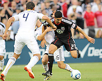 Pablo Hernandez #21 of D.C. United tangles with Omar Gonzalez #4 and Gregg Berhalter #16 of the Los Angeles Galaxy during an MLS match at RFK Stadium on July 18 2010, in Washington D.C. Galaxy won 2-1.