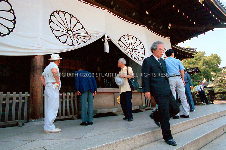 5/29/02--Tokyo, Japan. .Veterans of WW2 pay respects at the controversial Yasukuni Shrine where war criminals remains are kept....All photographs ©2003 Stuart Isett.All rights reserved.This image may not be reproduced without expressed written permission from Stuart Isett.