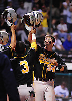 Jun. 1, 2010; Grand Junction, CO, USA; Southern Nevada Coyotes right fielder Bryce Harper (right) celebrates a home run against Iowa Western C.C. during the Junior College World Series as Suplizio Field. Southern Nevada won the game 12-7. Mandatory Credit: Mark J. Rebilas-