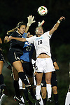 09 October 2014: North Carolina's Lindsey Harris (23) reaches for the ball while being challenged by Wake Forest's Claudia Day (left) and North Carolina's Joanna Boyles (right). The University of North Carolina Tar Heels hosted the Wake Forest University Demon Deacons at Fetzer Field in Chapel Hill, NC in a 2014 NCAA Division I Women's Soccer match. UNC won the game 3-0.