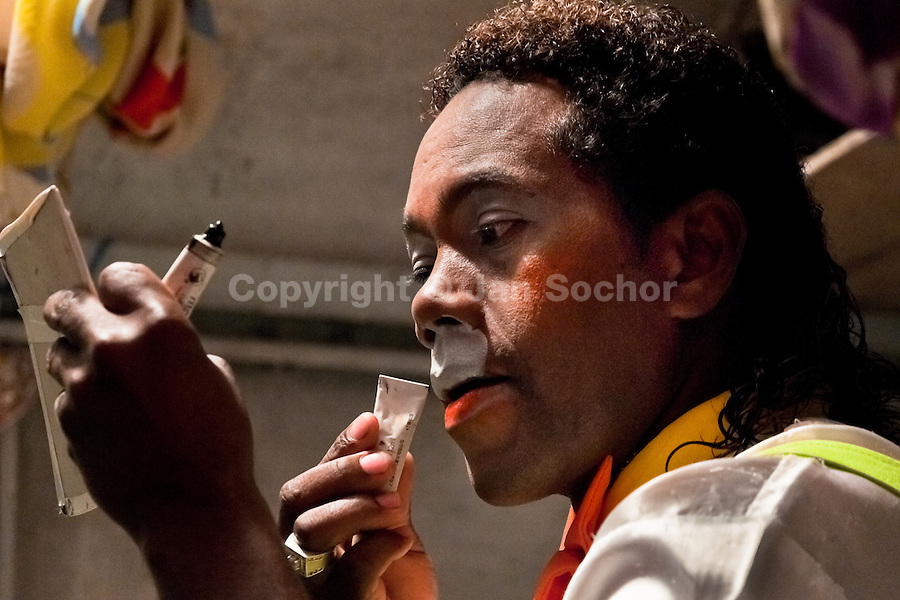 Walter, a Colombian clown, applies makeup before a performance at the Circo Anny, a family run circus wandering the Amazon region of Ecuador, 4 July 2010. The Circo Anny circus belongs to the old-fashioned traveling circuses with a usual mixture of acrobat, clown and comic acts. Due to the general loss of popularity caused by modern forms of entertainment such as movies, TV shows or internet, these small family enterprises balance on the edge of survival. Circuses were pushed away and now they have to set up their shows in more remote villages. The circus art and culture is slowly dying.