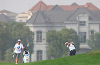 Thongchai Jaidee (THA) plays his 2nd shot on the 10th hole during Friday's Round 2 of the 2014 BMW Masters held at Lake Malaren, Shanghai, China 31st October 2014.<br /> Picture: Eoin Clarke www.golffile.ie
