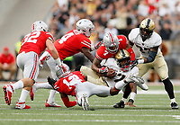 Ohio State Buckeyes safety Damon Webb (7) and cornerback Denzel Ward (12) tackle Army Black Knights quarterback Ahmad Bradshaw (17) during the second quarter of the NCAA football game at Ohio Stadium in Columbus on Sept. 16, 2017. [Adam Cairns / Dispatch]