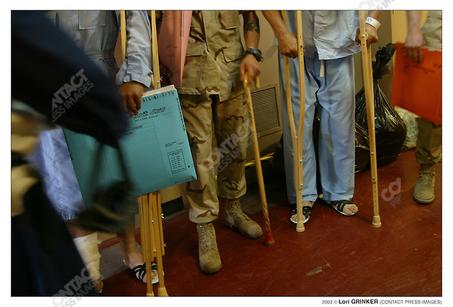 Wounded American patients wait to be excorted to the flight deck to be sent either to a land based hospital, home or back to their units. USNS COMFORT Naval hospital ship in the Persian Gulf.