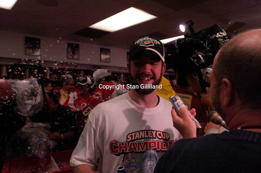 Cam Ward speaks to a reporter in the locker room after winning the Con Smythe Trophy. The Carolina Hurricanes beat the Edmonton Oilers 3-1 in game seven to take the Stanley Cup at the RBC Center in Raleigh, NC Monday, June 19, 2006.