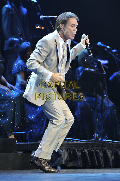 Cliff Richard.Performing live in concert at the O2 Arena, Greenwich, London, England. 25th October 2011.stage gig performance music on full length beige grey gray suit jacket white shirt arms dancing side profile.CAP/MAR.© Martin Harris/Capital Pictures.