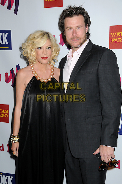 TORI SPELLING & DEAN McDERMOTT.22nd Annual GLAAD Media Awards held at the Westin Bonaventure Hotel, Los Angeles, California, USA,    .10 April 2011..half length black silk satin dress grey gray jacket white shirt couple husband wife married halterneck pearls beads .CAP/ADM/BP.©Byron Purvis/AdMedia/Capital Pictures.