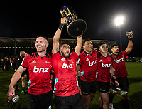 Crusader players celebrate with the trophy following the 2018 Super Rugby final between the Crusaders and Lions at AMI Stadium in Christchurch, New Zealand on Sunday, 29 July 2018. Photo: Joe Johnson / lintottphoto.co.nz