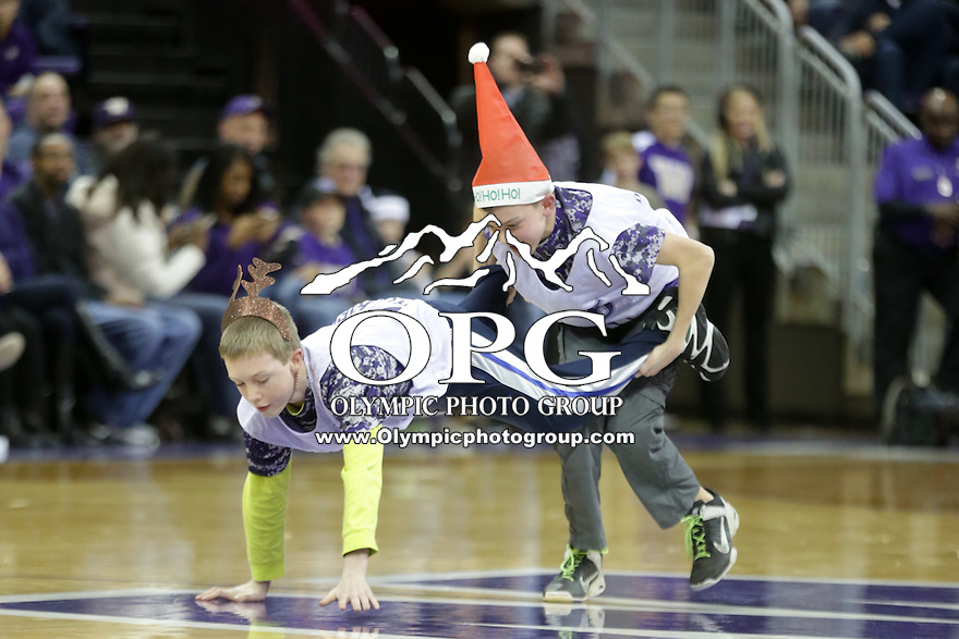 DEC 22, 2015:  Washington fans competed during a timeout for prizes against Seattle University. Washington defeated Seattle University 79-68 at Alaska Airlines Arena in Seattle, WA.