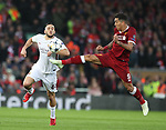 Kostas Manolas of AS Roma challenged by Roberto Firmino of Liverpool during the Champions League Semi Final 1st Leg match at Anfield Stadium, Liverpool. Picture date: 24th April 2018. Picture credit should read: Simon Bellis/Sportimage