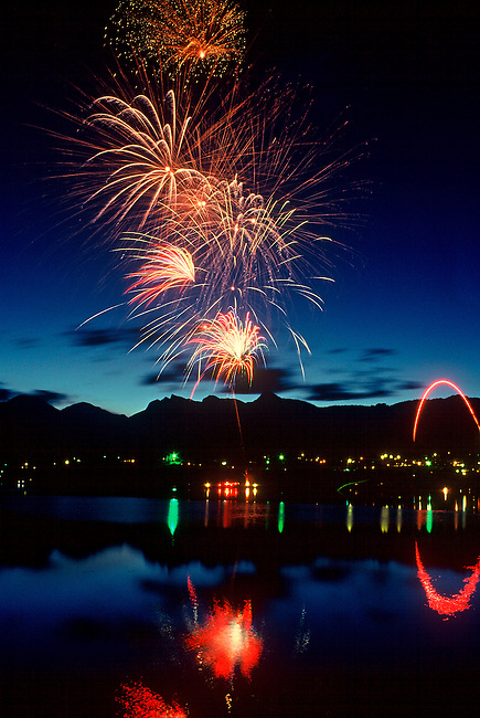 Fireworks fill the sky over Lake Estes during the 4th of July celebration in Estes Park, Colorado.
