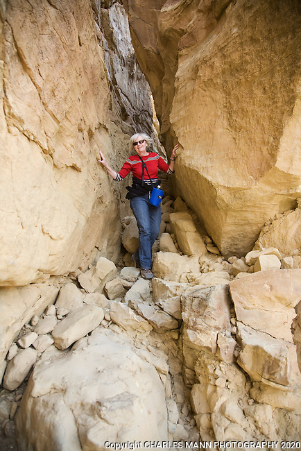 A hiker descends the steep trail leading up to the mesa at the start of the Pueblo Alto Trail in Chaco Culture National Historical Park in New Mexico.